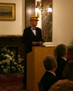 The final speech, Chairman Jonathan Healy with aircraft protection measures donated by Michael Wilby.